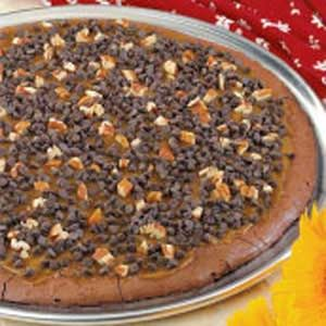 Caramel Brownie Pizza Recipe -This moist fudgy pizza topped with caramel, chips and nuts is sure to satisfy your family's sweet tooth. To prevent the tips of wedges from breaking when serving, I keep the topping thinner in the center. —Amy Branson, Bristol, Nevada