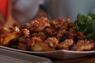 Chicken wings or drumettes are baked with a sweet and spicy glaze until tender, browned, and delicious!
