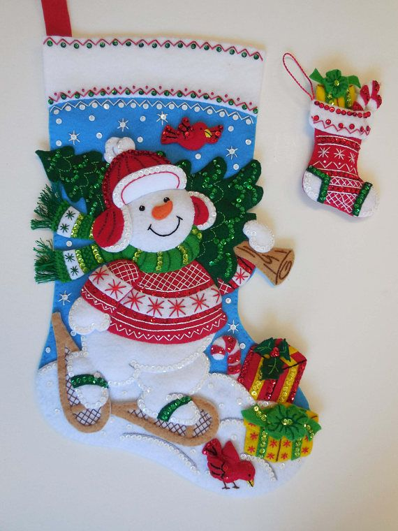 Made from a new 2017 Bucilla kit, this stocking measures 18 (45.7 cm) from hanger to toe. Stuffed for a 3-D effect, it comes with white felt LINING, backing and reinforced hanger. Completely hand-sewn with lots of aloha. No glue or machine used. Included is a matching stocking