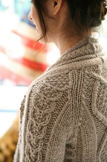 Aidez - Free  Aidez is a feminine fitted cardigan that has all the cozy antique appeal of traditional Aran texture.