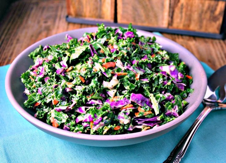 Kale Slaw - kale, purple cabbage, and carrots tossed with homemade poppy seed dressing is a healthy alternative to traditional cole slaw.