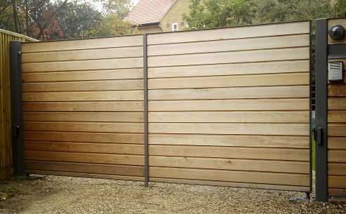 Metal, Timber and Automatic Electric Gates, Surrey UK - like the horizontal timber with industrial frame