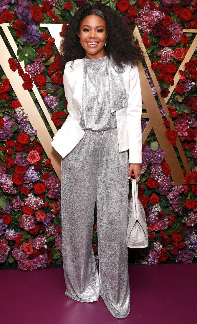 Gabrielle Union in a silver jumpsuit and white blazer