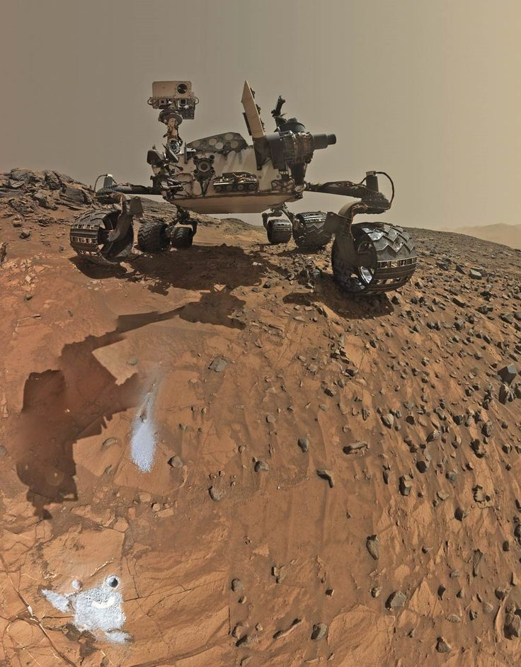 """After an eight-month interplanetary trip, the Mars Science Laboratory arrived at Mars five years ago this week. Its automatic entry, descent, and landing phase, known popularly as the """"seven minutes of terror,"""" saw Curiosity survive entry into the Martian atmosphere, decelerate further by employing a series of parachutes, and finally be lowered onto the surface of Mars from a hovering """"sky crane. """"Image credit: NASA / JPL-Caltech / MSSS"""