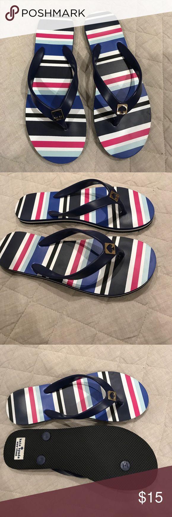 Kate Spade Flip Flops Brand new, never worn navy stripe flip flops with gold emblem kate spade Shoes Sandals