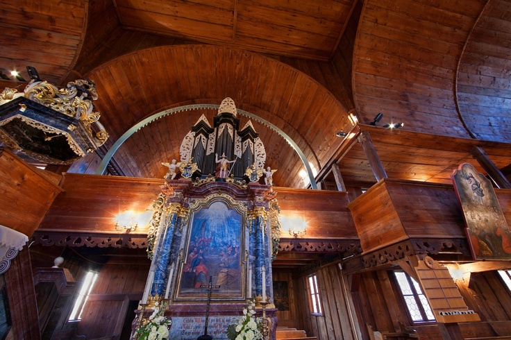 The wooden articled church in Hronsek from 1726 is set in the wonderful environment of big lime trees near Banska Bystrica. There are 1,100 chairs in this church.