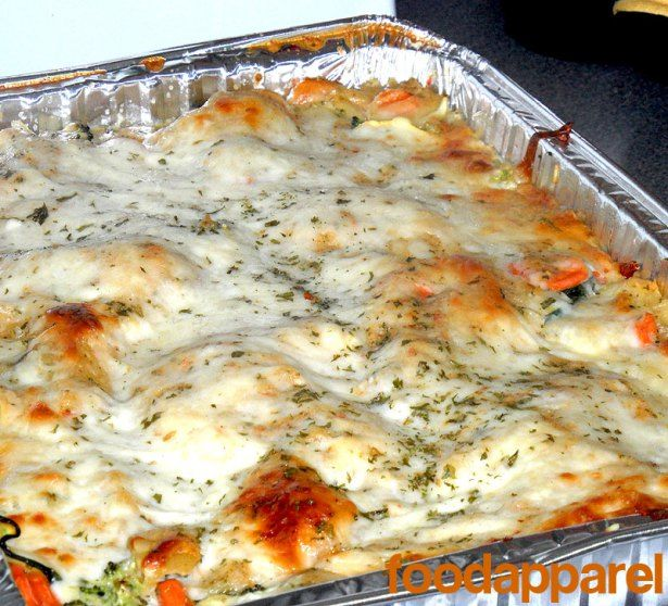 For a vegetarian-style lasagna not lacking any flavor, try out this delicious vegetable lasagna with a white sauce. Hearty cheesy goodness! FoodApparel.com.