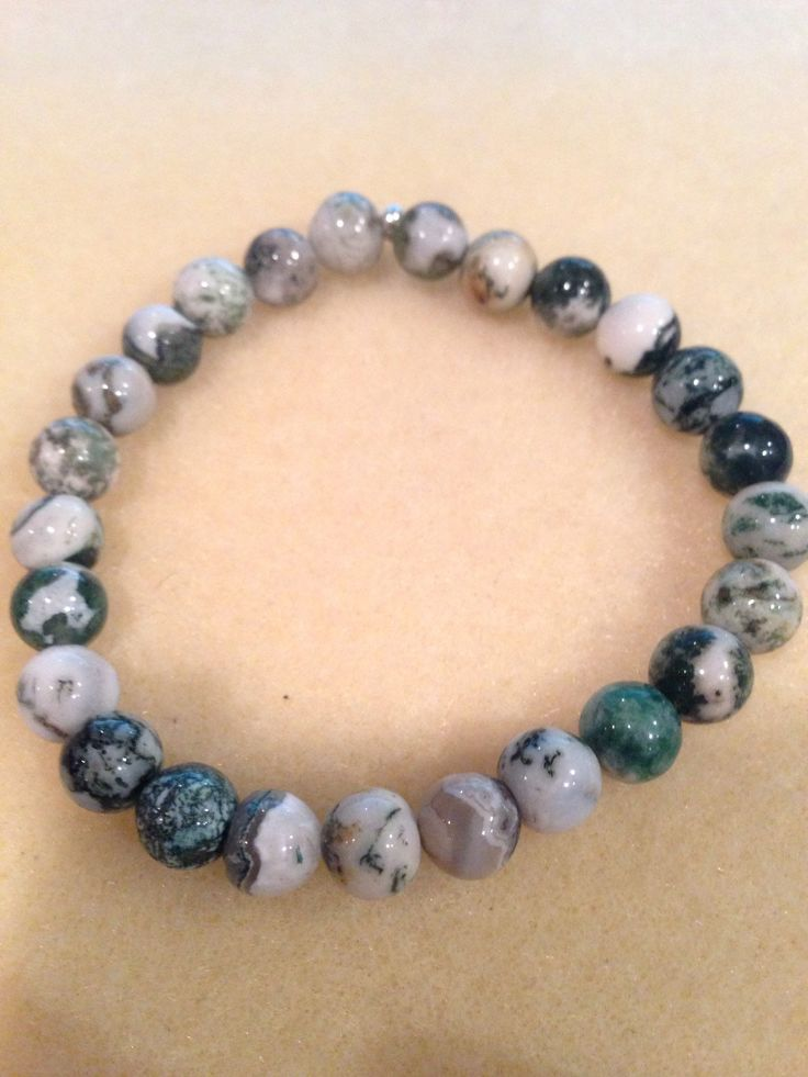 Now trending: Tree Agate 8mm Round Bead Bracelet with Sterling Silver Accent https://www.etsy.com/listing/243474973/tree-agate-8mm-round-bead-bracelet-with?utm_campaign=crowdfire&utm_content=crowdfire&utm_medium=social&utm_source=pinterest