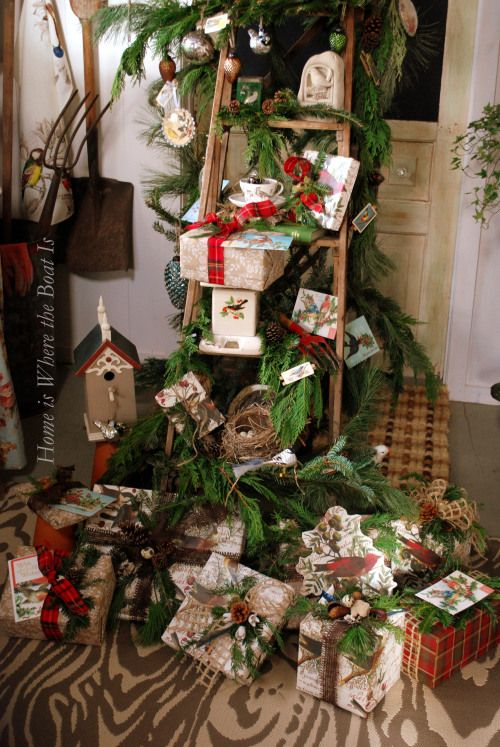 Beautiful display!—Love the ladder & whole overall  look—the natural embellishment of these gifts & props. The designer is very talented. Follow link to see other pics from: Home is Where the Boat Is