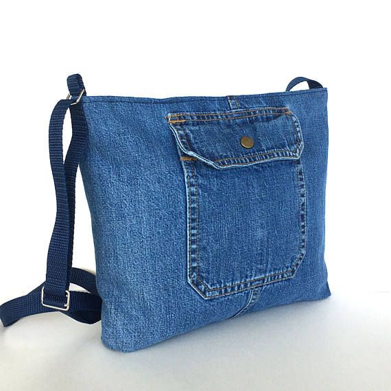 9e407a2ab23 This medium size zip-top bag is made from retired jean pant in blue colour.  Two exterior pockets make perfect places to stash oft-used items.