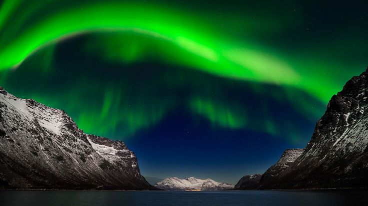 Tromso, Norway; stunning mountains and fjords. Absolutely beautiful, would be speechless if I saw it in person I have no doubt.