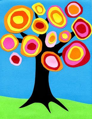 Start with a blue sheet of paper. Cut out a grass shape from a green paper. Cut out a tree trunk and branches shape from black or brown paper. Cut out various sizes of circles from fall colored papers then layer them.