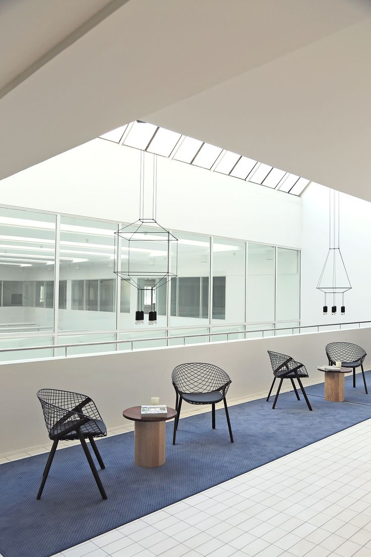 Office space lounge in Espoo Finland. Interior design by Poiat. Lights, Vibia Wireflow; Chairs, Alias Kobi; Tables, Karl Andersson & Söner Cap