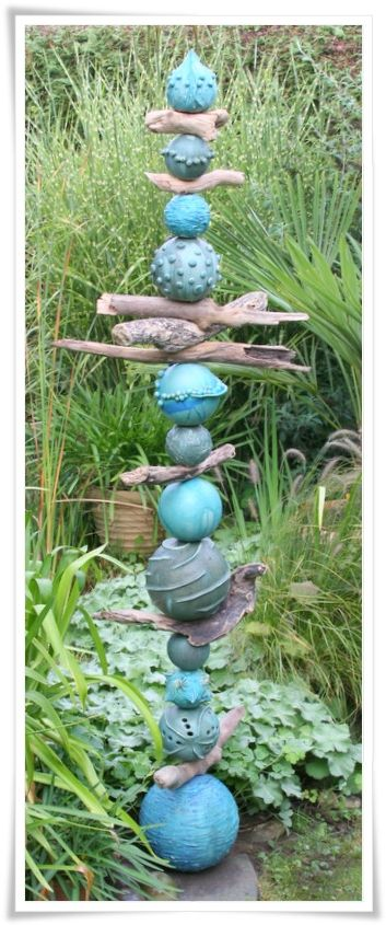 Someone else pinned this, but this totem will be an inspiration for me. Love the color; love the driftwood pieces.