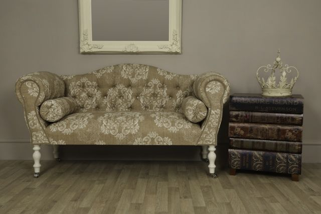 This beige & white floral traditional style sofa with wooden turned legs is a traditional antique style sofa upholstered in a beige and white floral fabric