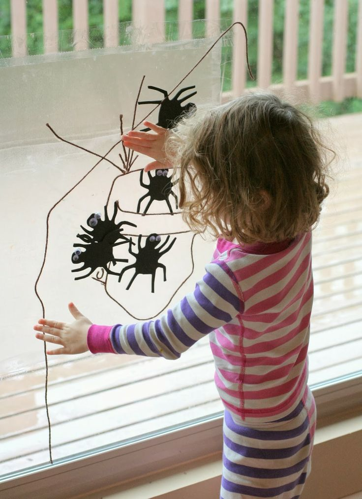 Sticky Paper Window Art:  Halloween Spider Web from Fun at Home with Kids