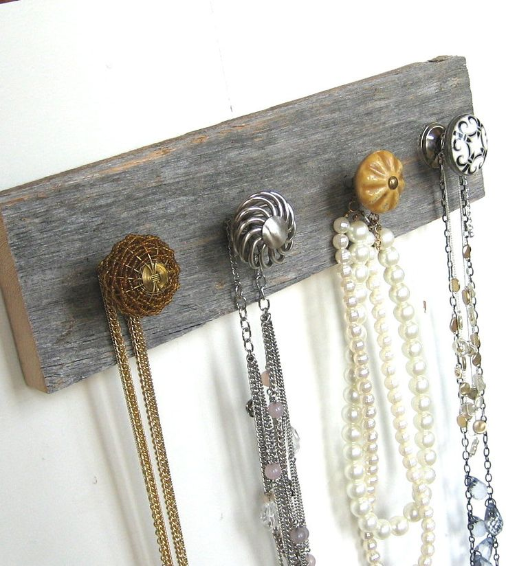 "Necklace Organizer ""Silver and Gold"" Jewelry Rack on Reclaimed Barn Wood. $30.00, via Etsy."