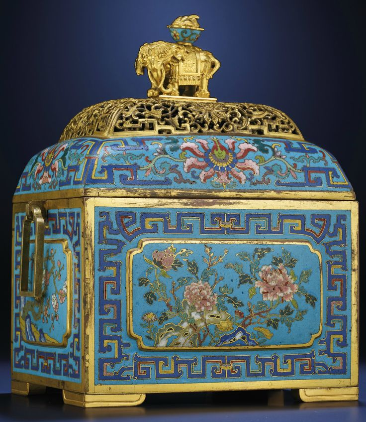 A RARE CLOISONNE ENAMEL RECTANGULAR CENSER AND COVER  QING DYNASTY, 17TH/18TH CENTURY  The rectangular vessel is raised on four thick 'V'-shaped feet, with the sides decorated with Flowers of Four Seasons within stylised dragon scroll borders.