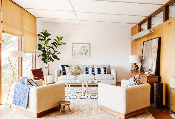 Midcentury Los Feliz rental, which was originally designed by a Japanese architect. DISC integrated aged brass, jute rugs, and earthy ceramics, speaking to the natural materials and tonal color palette of the house.