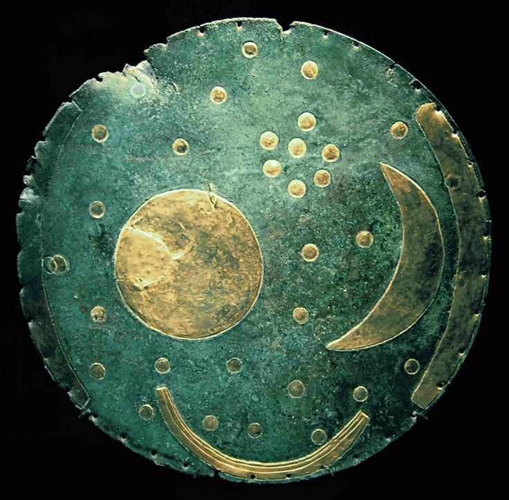 The Nebra Sky Disk, attributed to a site near Nebra, Saxony-Anhalt, Germany, is a bronze disk about 30 cm in diameter, with a blue-green patina inlaid with gold symbols which have generally been interpreted as a sun or full moon, a lunar crescent, and stars, including a cluster interpreted as the Pleiades. The disk is associated with Bronze Age Unetice Culture, 1600 B.C.