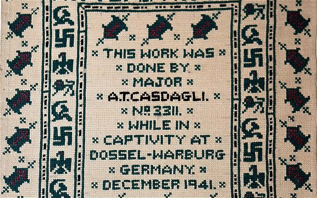 A Prisoner of War stitched up his German captors after they unwittingly displayed his needlework containing the message 'God Save the King' and 'F**k Hitler' in morse code around the border.