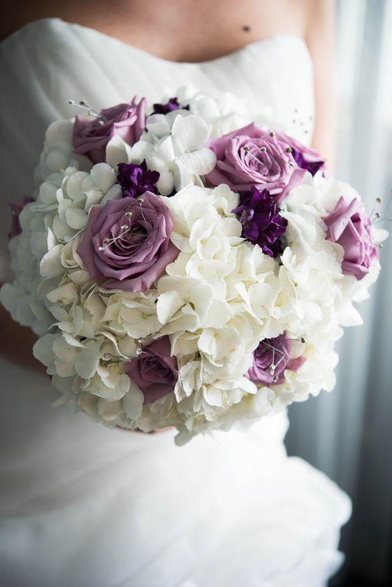 Elegant white and purple rose wedding bouquet; Featured Photographer: Elizabeth Nord Photography