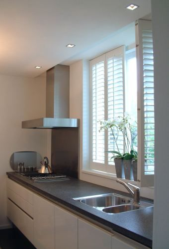 Desperately need shutters or blinds for the kitchen window. That way we wouldn't need to wash up with our eyes closed LOL