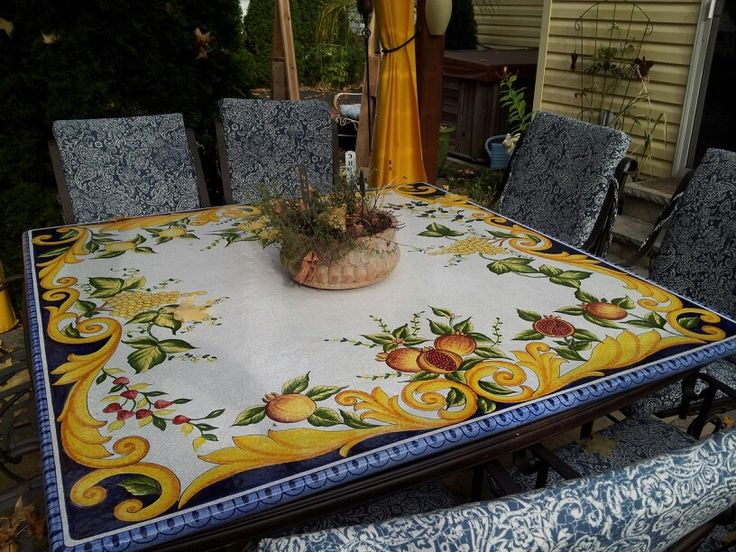 All weather hand painted lava stone tabletop. Stays out all year. Great for al fresco dining. From Mediterranean Ceramics in Malta.