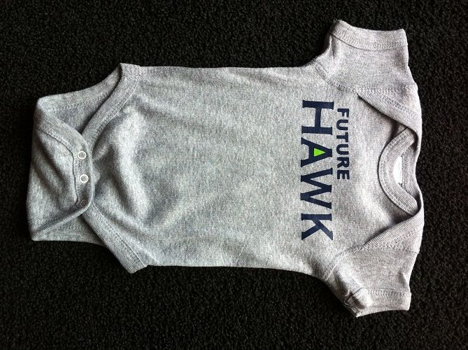 Seahawk onesie He definately will be with a daddy like daniel!!!   I found this website that has very trendy and cute clothes for children, the best part is that its all affordable too!!