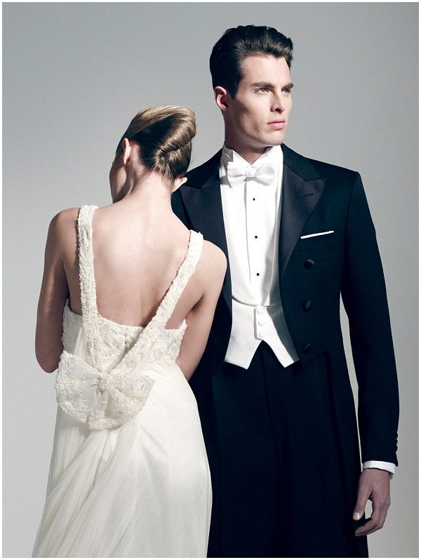 glamour wedding dress with groom in tuxedo