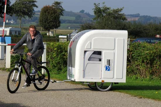 WidepathCamper is a Danish bicycle camper that expands into a room with a bed.