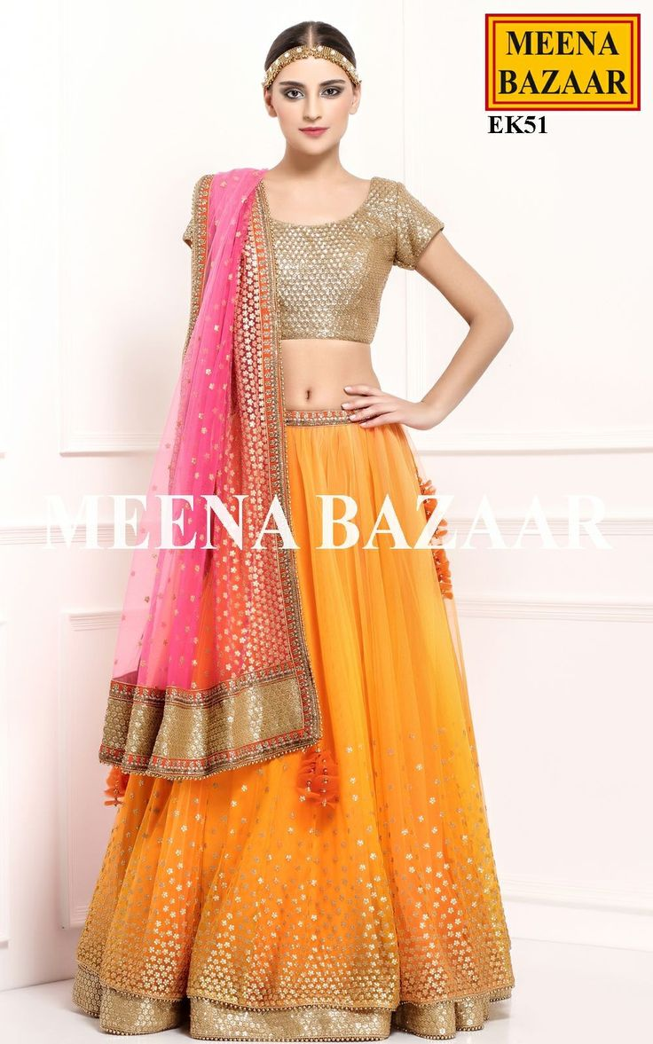 Bright yellow lehenga with pink chunni and  a bronze gold blouse.. Found it on their main web page