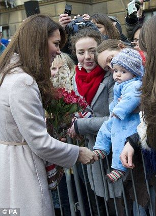 Family matters: Neither the Duke of Cambridge nor the Duchess of Cambridge have made a secret of their desire for children. Kate is pictured meeting James William Davies in Cambridge just last week. By PA on DailyMailUK.