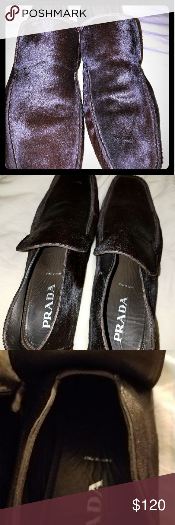 Men's PRADA Pony Fur Shoes Men's Black Prada Pony Fur Shoes, originally purchased and made in Italy. Never worn. Originally paid $500. Perfect condition. Well made sleek shoes that can be dressed up or down. Size 13, however they are more on the narrow side. Prada Shoes Loafers & Slip-Ons