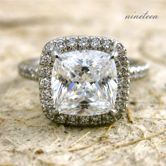 I usually don't like square rings, but I like this one.. the thin diamond band and the band around the center stone is gorgeous