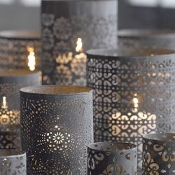 Great entry lantern idea: Pre-punched paper at Michael's, wrap it around a