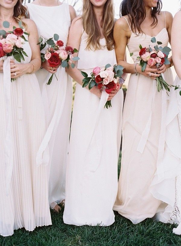 Tie together their small bouquets with long ribbon, allowing it to cascade down for an airy effect  @myweddingdotcom