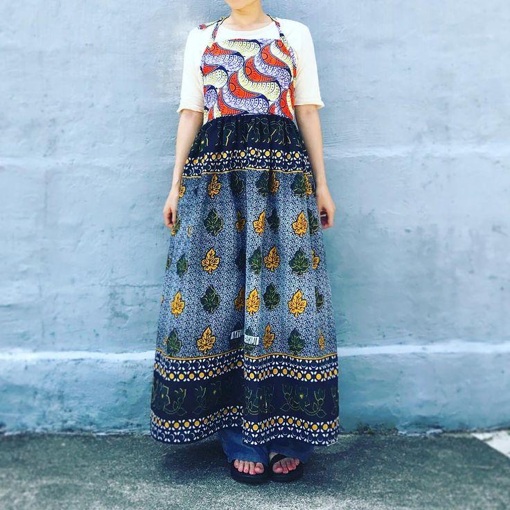 """""""日常で着られるアフリカンファブリック""""をコンセプトにアフリカの布、カンガを使ったエプロン風ワンピース。ハンドメイドで仕立てた1点物。"""