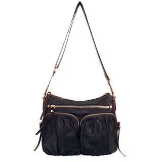 Paige, our best-selling cross-body style, is the essential bag for the busy woman on the move. Lightweight with an adjustable-length shoulder strap, Paige keeps your hands free for work or play. In classic black Bedford Nylon with custom MZ Wallace gold hardware. Finished with our signature red edge-dye.