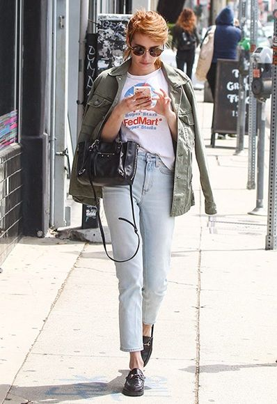 Emma Roberts wearing blue jeans, printed t-shirt, khaki jacket and gucci loafers
