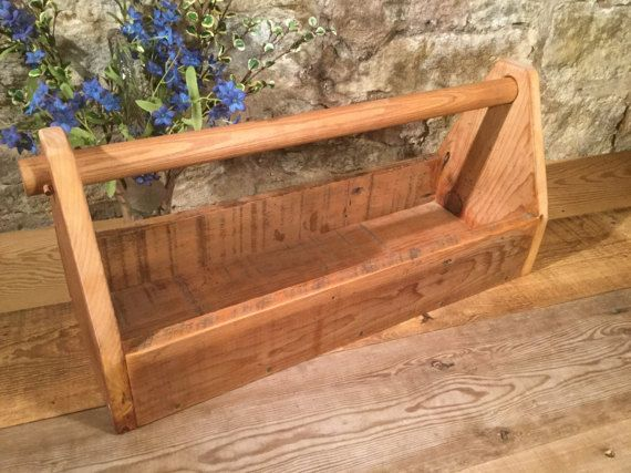 This wooden tool caddy is made from genuine reclaimed old barn wood from Minnesota. We own the barn, which is over 100 years old. The handle is pegged on each end rather than screwed in. The ends are both glued and nailed. No two tool caddies will be iden