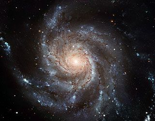 """This new Hubble image reveals the gigantic Pinwheel galaxy, one of the best known examples of """"grand design spirals"""", and its supergiant star-forming regions in unprecedented detail. The image is the largest and most detailed photo of a spiral galaxy ever taken with Hubble."""