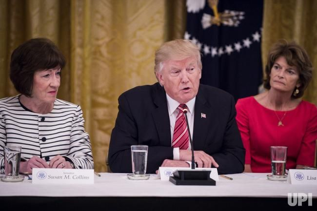 GOP healthcare plan holdouts, Senators Susan Collins, R-Maine and Lisa Murkowski, R-Alaska, flank President Trump as he speaks to…