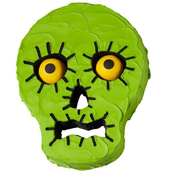 Surprised Green Skull Cake - This frightfully easy skull cake will be the scream of your Halloween party! Bake in the Wilton Skull Tube Cake Pan and then decorate with tinted buttercream icing.