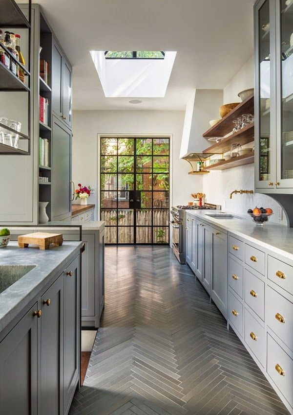 Herringbone Floors and Colored Cabinets with white countertops and backsplash
