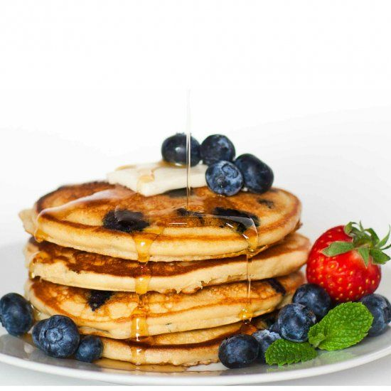 Delicious and fluffy blueberry vanilla pancakes, served with salted butter and maple syrup! Never buy any mix again! +Video