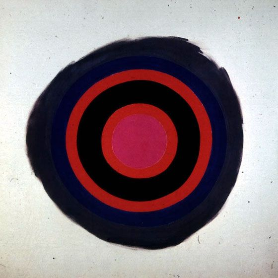 Kenneth Noland, Song, 1958  •painting as object  •Post-Painterly Abstraction  •Clement Greenberg- each medium has its logic and teleology. Painting must explore pigment on support. Invents post-painterly abstraction.  •Symmetry avoids relational composition  •Shape determines parts  •Industrial technique (limited touch)  •Industrial brushes   •Anti-expressive  •Non-rational