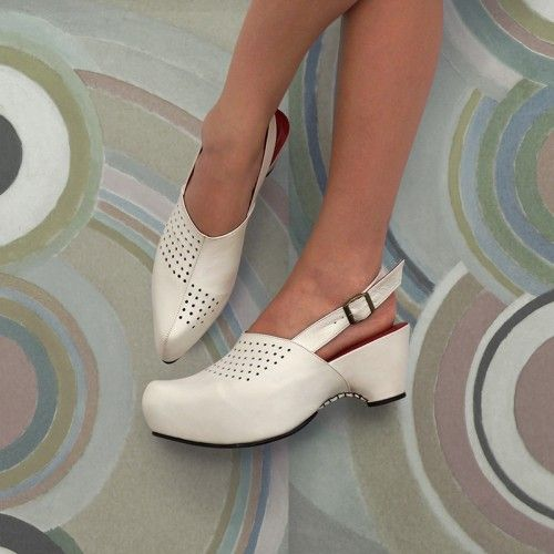 CAMILLE limited edition CLOG by Preston Zly. A composition of points and curves over a striking minimal form.  http://prestonzly.com/Collections/Towards_Wearable_Abstraction?product_id=155