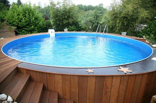 Above ground pool decks ideas wood pool deck wood steps round garden pool pool pinterest for Round swimming pools above ground