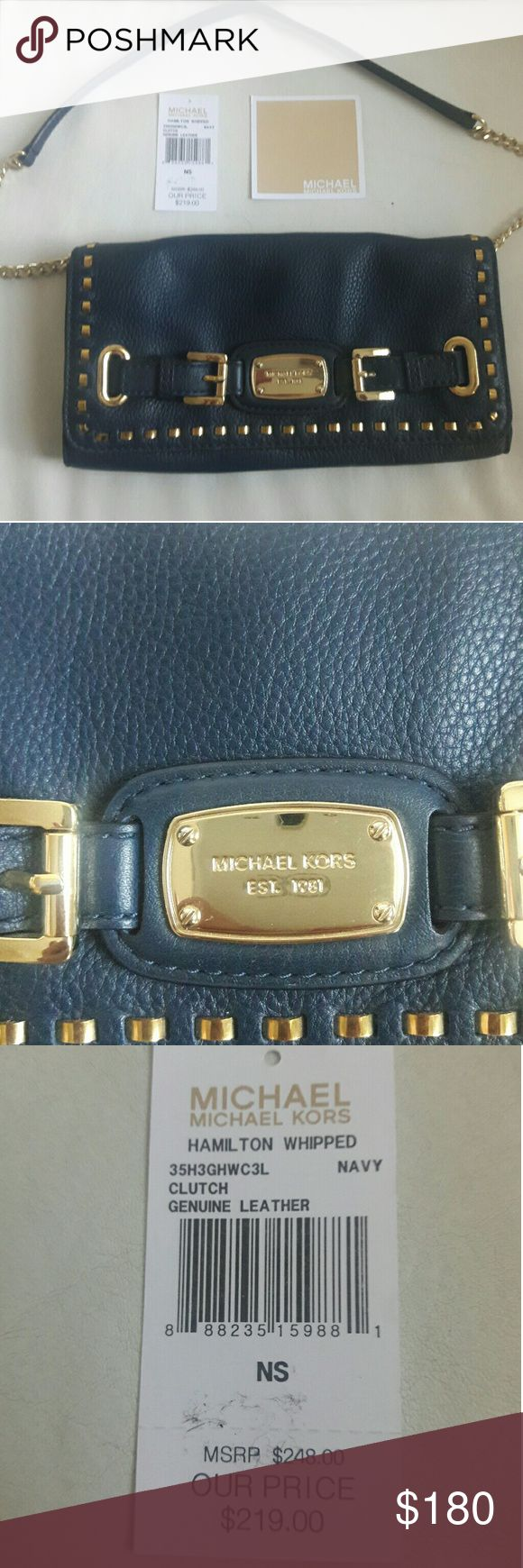 Michael Kors Leather clutch Michael Kors Hamilton whipped clutch navy. I only used it twice after I got it as a Christmas gift. Still has tags with it. Basically brand new Michael Kors Bags Clutches & Wristlets